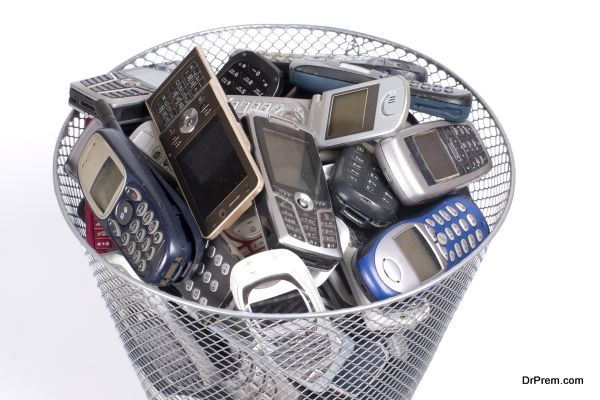 rubbish bin full of old cellphones