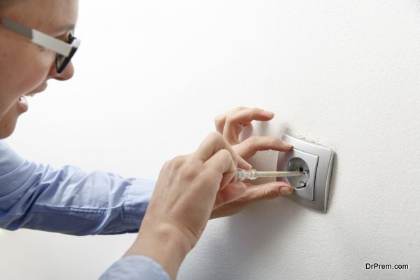Businesswoman installing a power socket