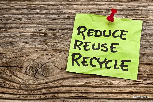 reduce, reuse and recycle reminder note against grained wood - resource conservation concept
