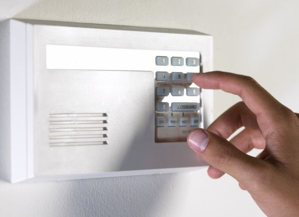 disarming alarm system --- Image by © Royalty-Free/Corbis