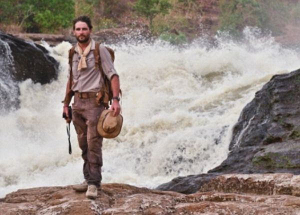 Levison Wood stands at the top of Murchsion Falls. The River Nile squeezes through a gap of six metres and drops forty metres to create one of the most epic sights on the whole course of the river and is called Murchsion Falls, named after the president of the Royal Geographical Society at the time when Samuel Baker first caught sight of the falls.  Levison is attempting to be the first person to ever walk the enitre length of the Nile. He is 1500km in of a 6500km total journey and started in Rwanda. He is expecitng to finish in Egypt before December 2014.