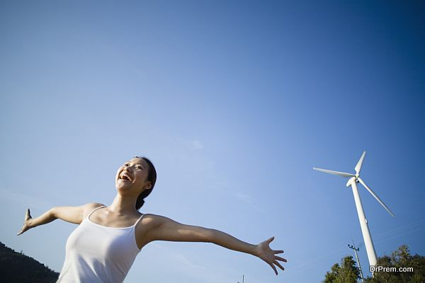 Young Woman by Wind Turbine