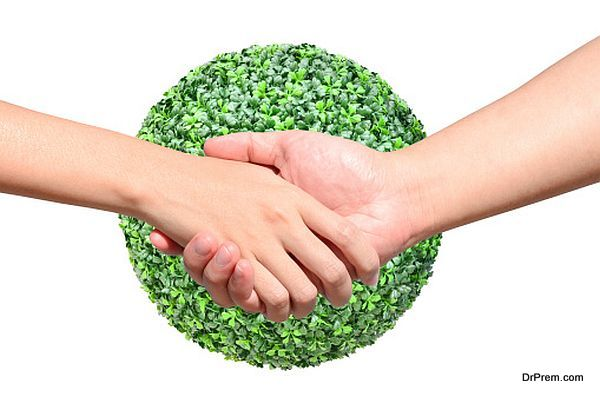 Partner hand between man and woman on green planet world