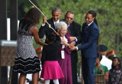 President Barack Obama, with first lady Michelle Obama and Ruth Odom Bonner, center, ring the bell opening the Smithsonian National Museum of African American History and Culture on the National Mall in Washington, Saturday, Sept. 24, 2016. (AP Photo/Manuel Balce Ceneta)