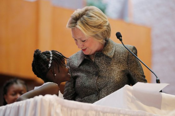 Nine-year-old Zianna Oliphant joins U.S. Democratic presidential nominee Hillary Clinton at the pulpit at the Little Rock AME Zion Church in Charlotte