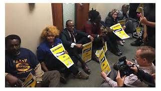 sit-in-in-hallway-outside-sessions-office