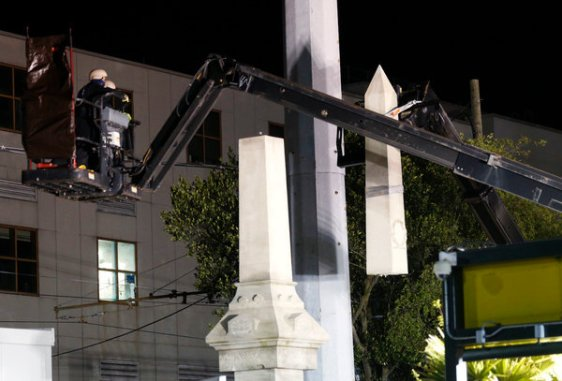 Workers in N. O. take down monument