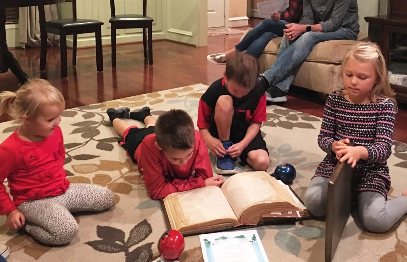 Children Reading the Bible at Christmas
