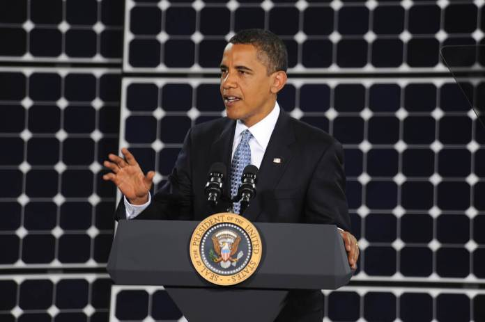 President Obama in front of solar panels