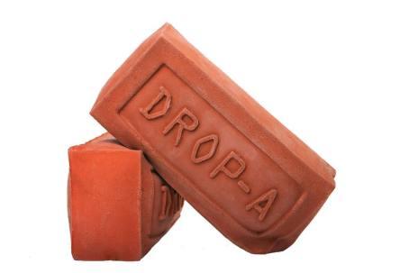 Drop a Brick water saving toilet accessory