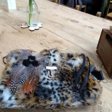 customized feather and pom-pom bag
