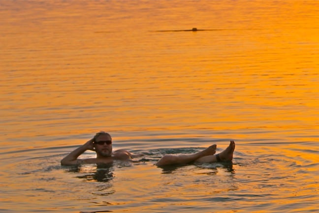 Floating in the Dead Sea Jordan at Sunset