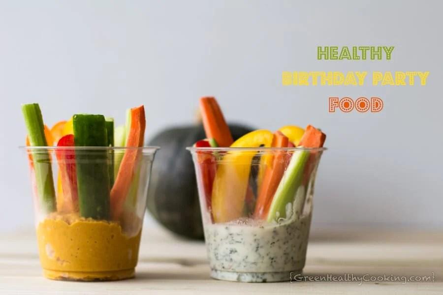 Pumpkin hummus with veggie sticks in a clear plastic cup, and quark dip with veggie sticks in a clear plastic cup, with text overlay.