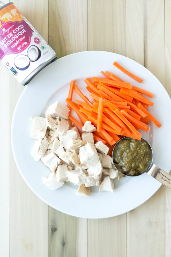 Quick and Easy Thai Green Curry Ingredients on a white plate on a wooden board.