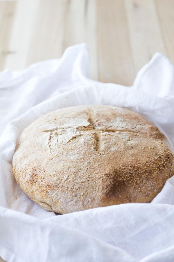 No-Knead Sesame Seed Bread on a white towel.