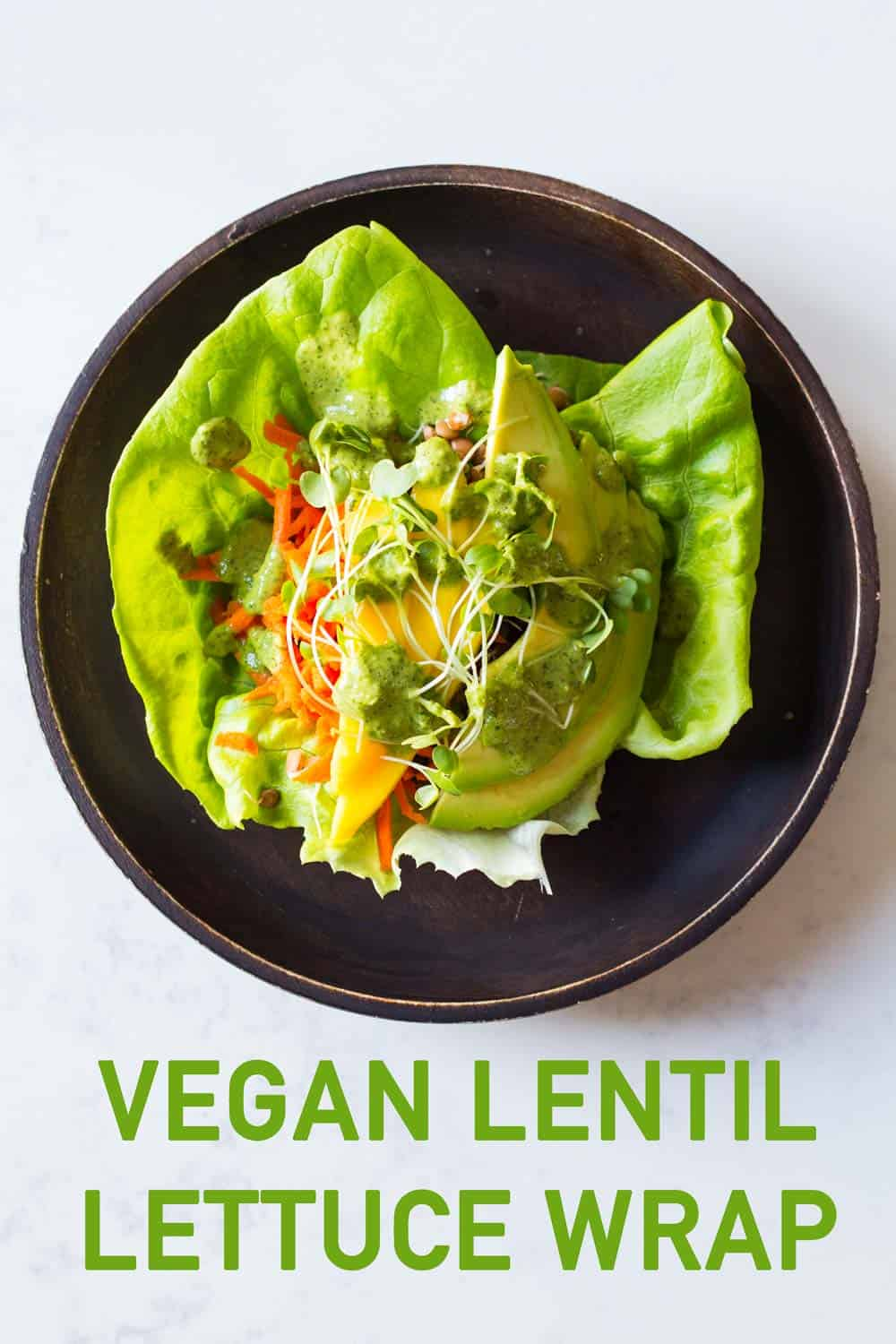 A healthy lettuce wraps recipe that will blow your mind. It's one of the most delicious things I've ever created! Lentils, avocado, mango, carrot and an out of this world Tahini Herb Sauce.