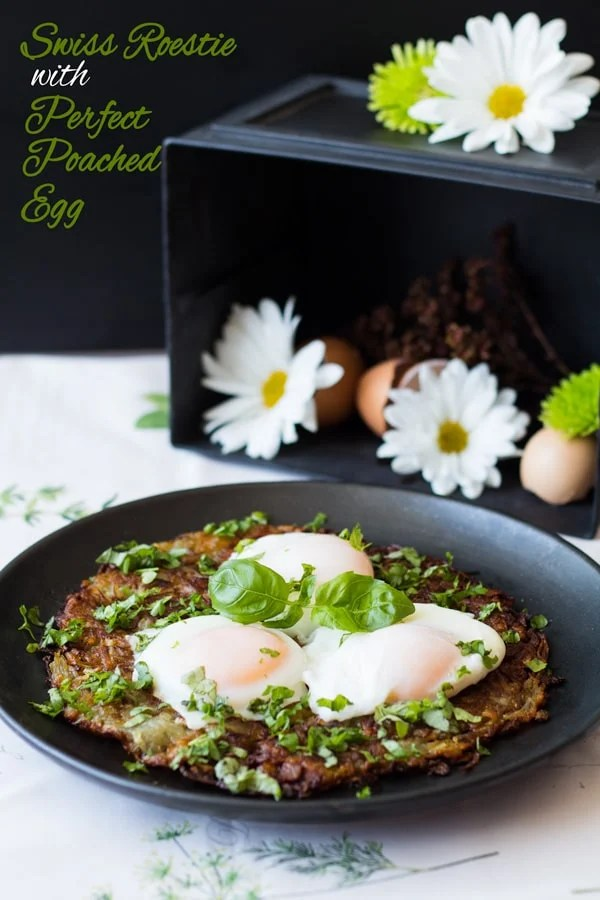 Swiss Roesti with Perfect Poached Egg on a black plate with flower in the background and text overlay.