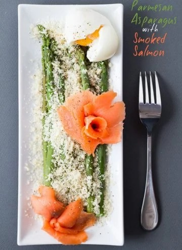 Top view of Parmesan Asparagus with Smoked Salmon on rectangular plate with a fork and text overlay.