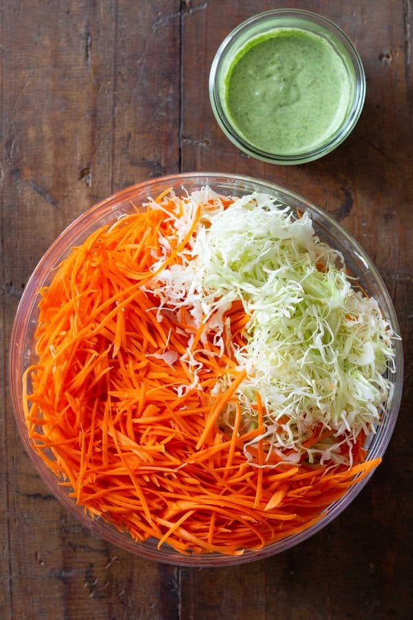 sliced cabbage and grated carrot in a large bowl