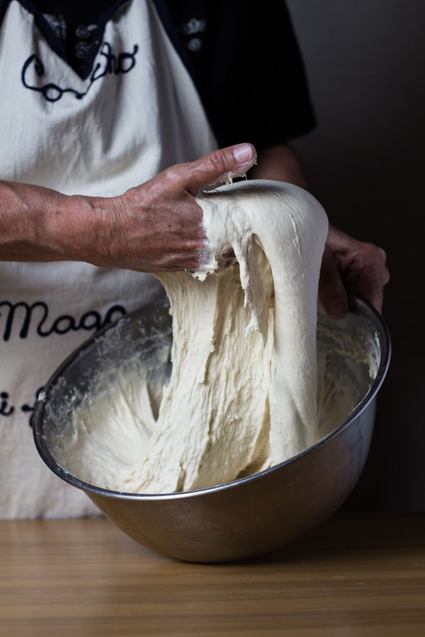 Bread dough hand kneading for authentic German Bread