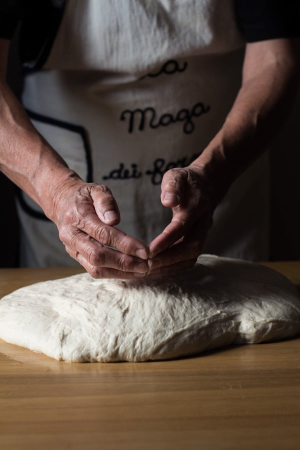Hands forming loafs of German Bread out of dough
