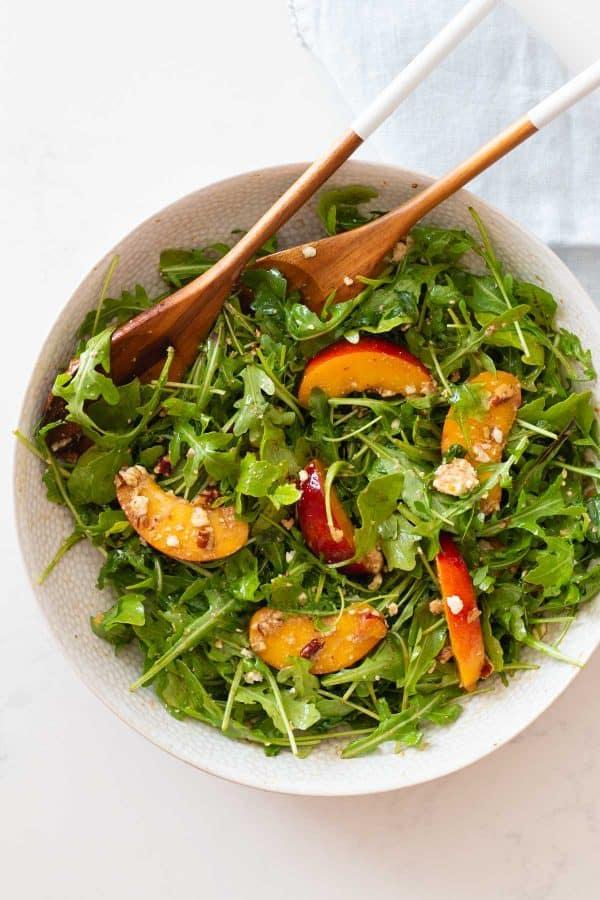 Mixed Nectarine Arugula Salad in a bowl