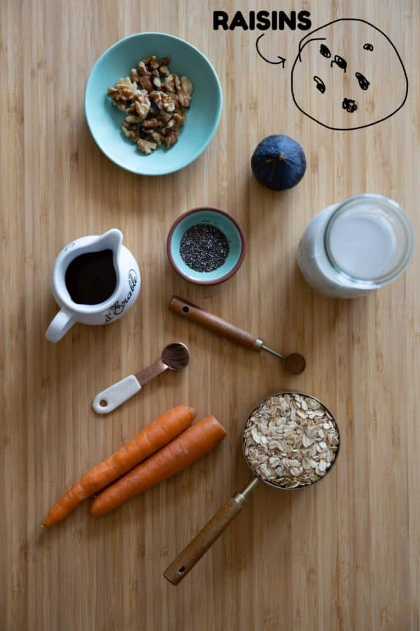 Individual ingredients for carrot cake oatmeal laid out on a kitchen counter.