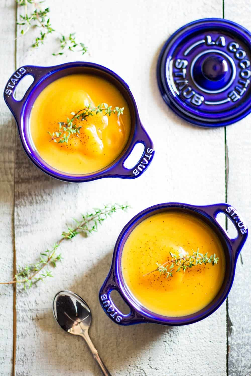 smooth butternut squash soup in blue cocotte