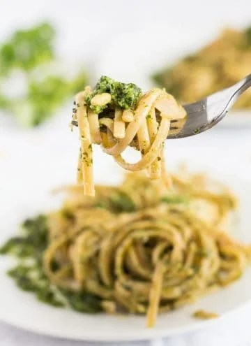 Close up of a fork grabbing some Shaved Brussels Sprouts Pasta with Herb Pesto.