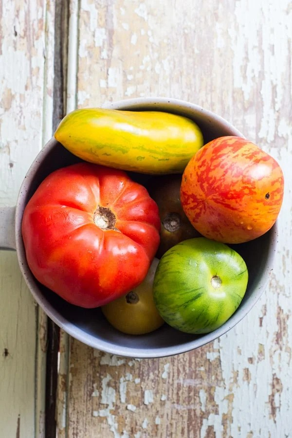 A bowl with heirloom tomatoes.