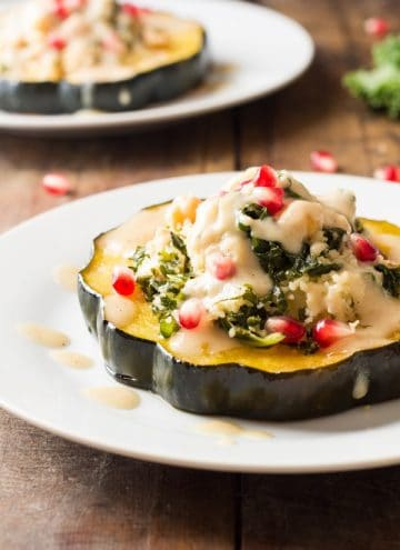 Two plates of Bulgur Stuffed Acorn Squash.