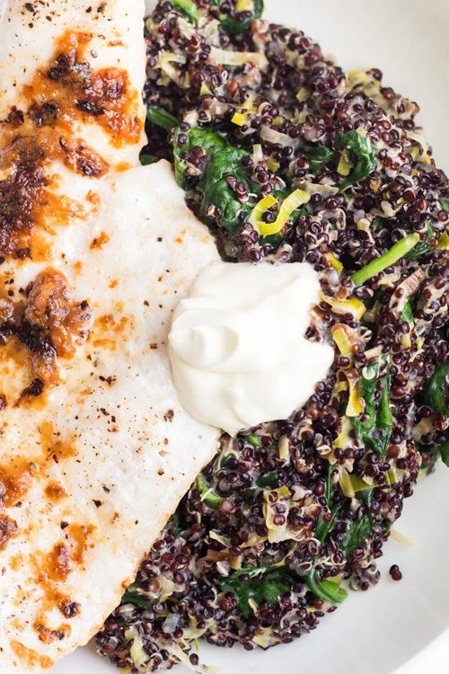 Close up of Haddock with Black Quinoa and creme fraiche viewed from the top.