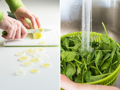 Left: hands slicing a leek on a white chopping board. Right: baby spinach in a strainer basket being washed under running water.
