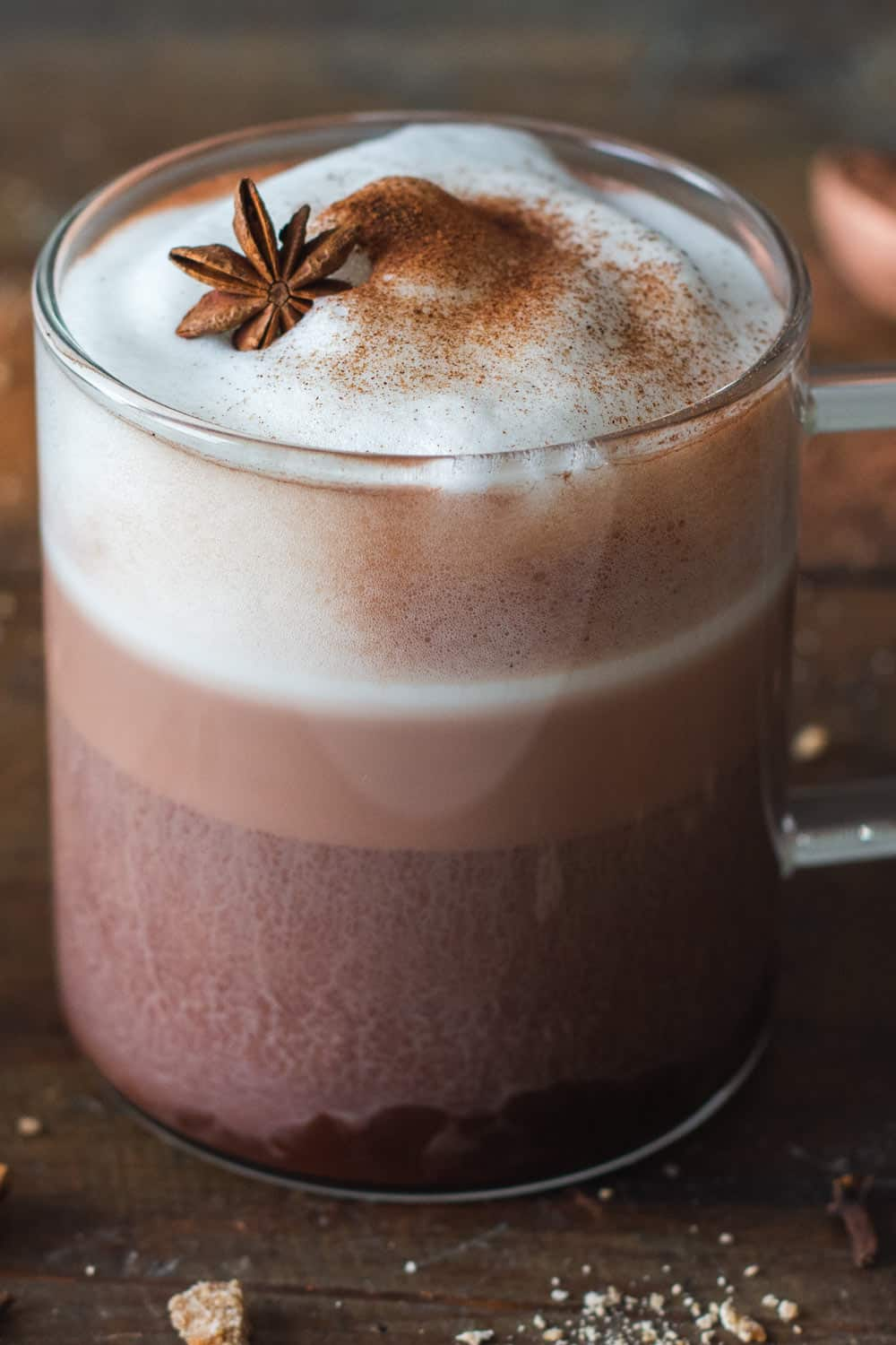 Mexican Hot Chocolate with frothed milk in a glass cup