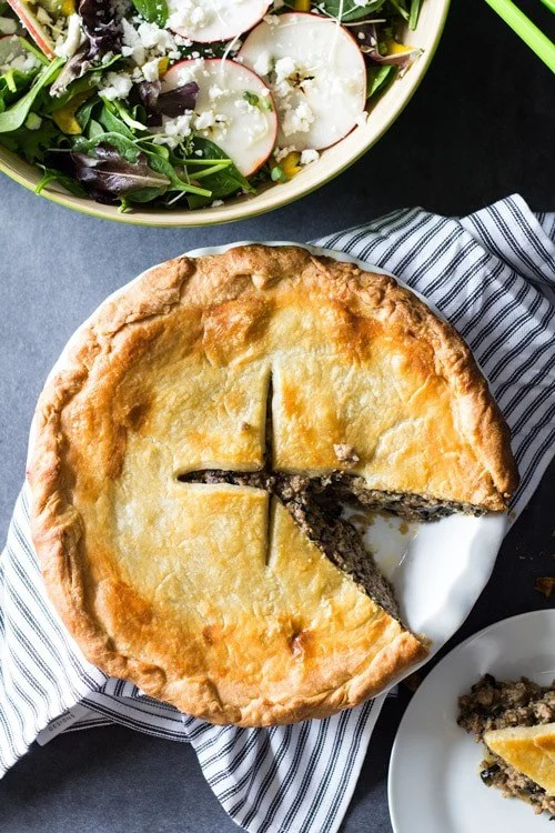 A Meat Pie recipe you'll want to stuff your face with. Ground pork, kale, dried cranberries and a perfect homemade puff pastry make it to DIE for!