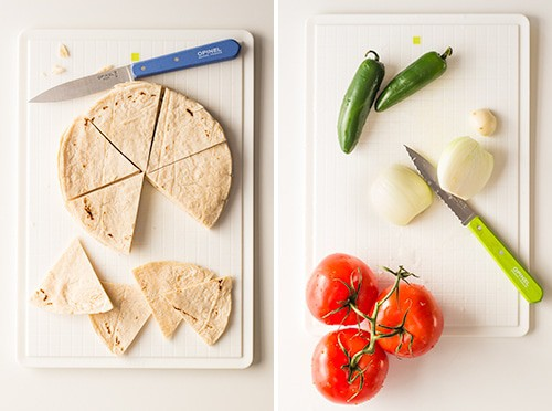 Left: tortillas cut into triangles with a knife on a cutting board. Right: serrano chiles, onion cut in half, and tomatoes on a cutting board.