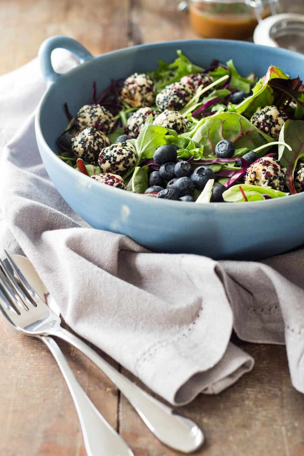 Warm Goat Cheese Salad in a blue salad bowl