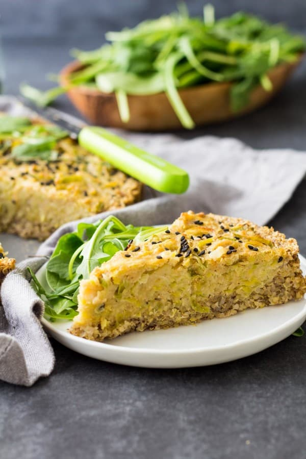 A slice of Vegan Quiche on a plate with salad.