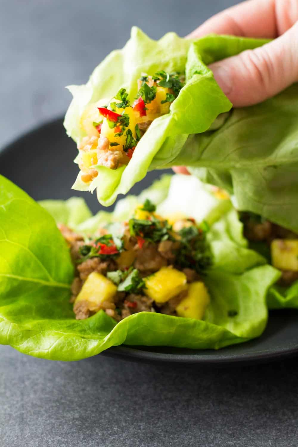 Close up of Ground Pork Lettuce Wrap in hand