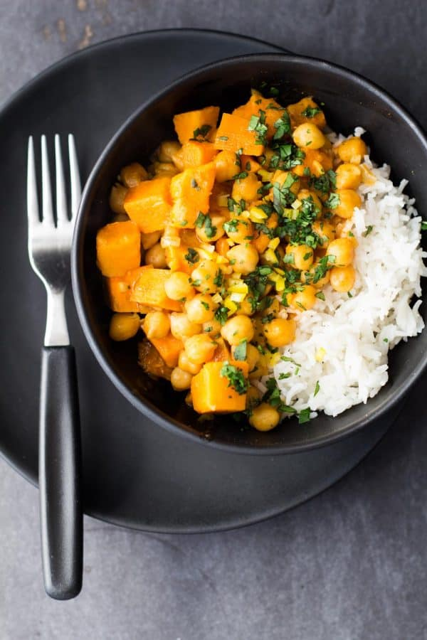 Sweet Potato and Chickpea Curry in black bowl