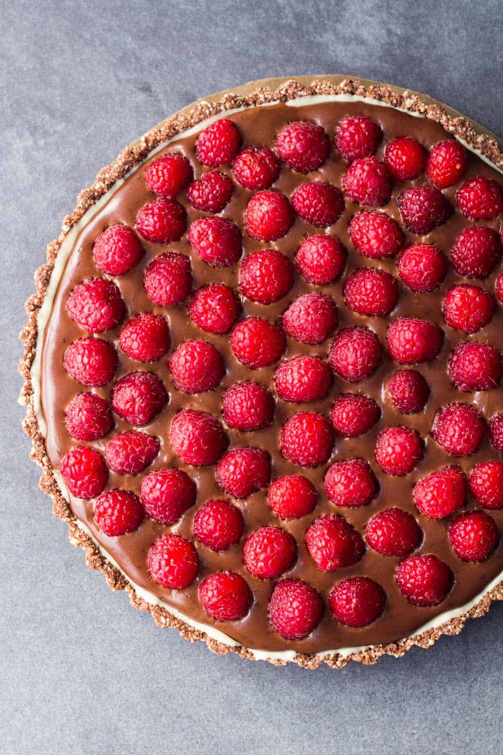 Chocolate Raspberry Tart with Almond Crust and white chocolate layer in between.