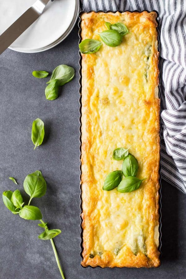 smoked salmon asparagus quiche in rectangular baking pan