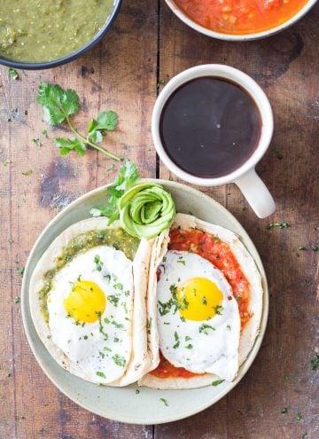 Huevos Divorciados - tortilla with salsa verde with egg and tortilla with salsa roja with egg