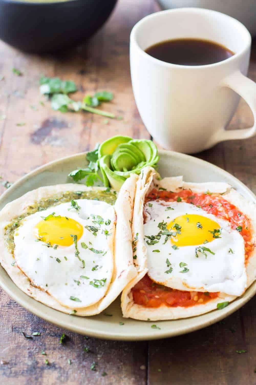 Huevos Divorciados on a green plate