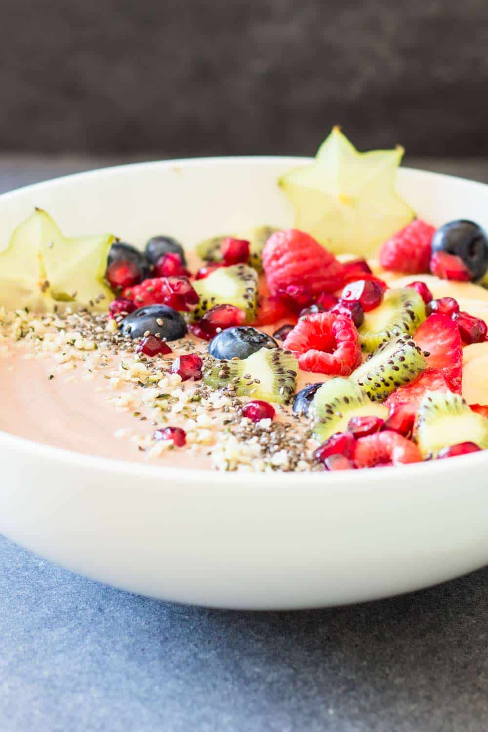 Close up of Chocolate Smoothie Bowl with chopped fresh fruit to show texture.