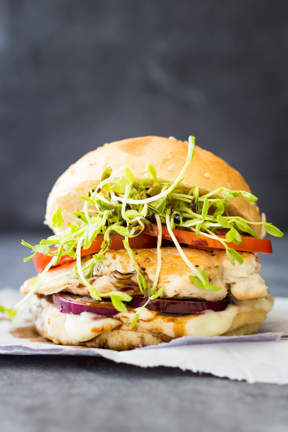 Recipe for a simple and Easy Grilled Chicken Burger made with chicken breast, tomato, microgreens, red onions and delicious 2-minute homemade mayonnaise!