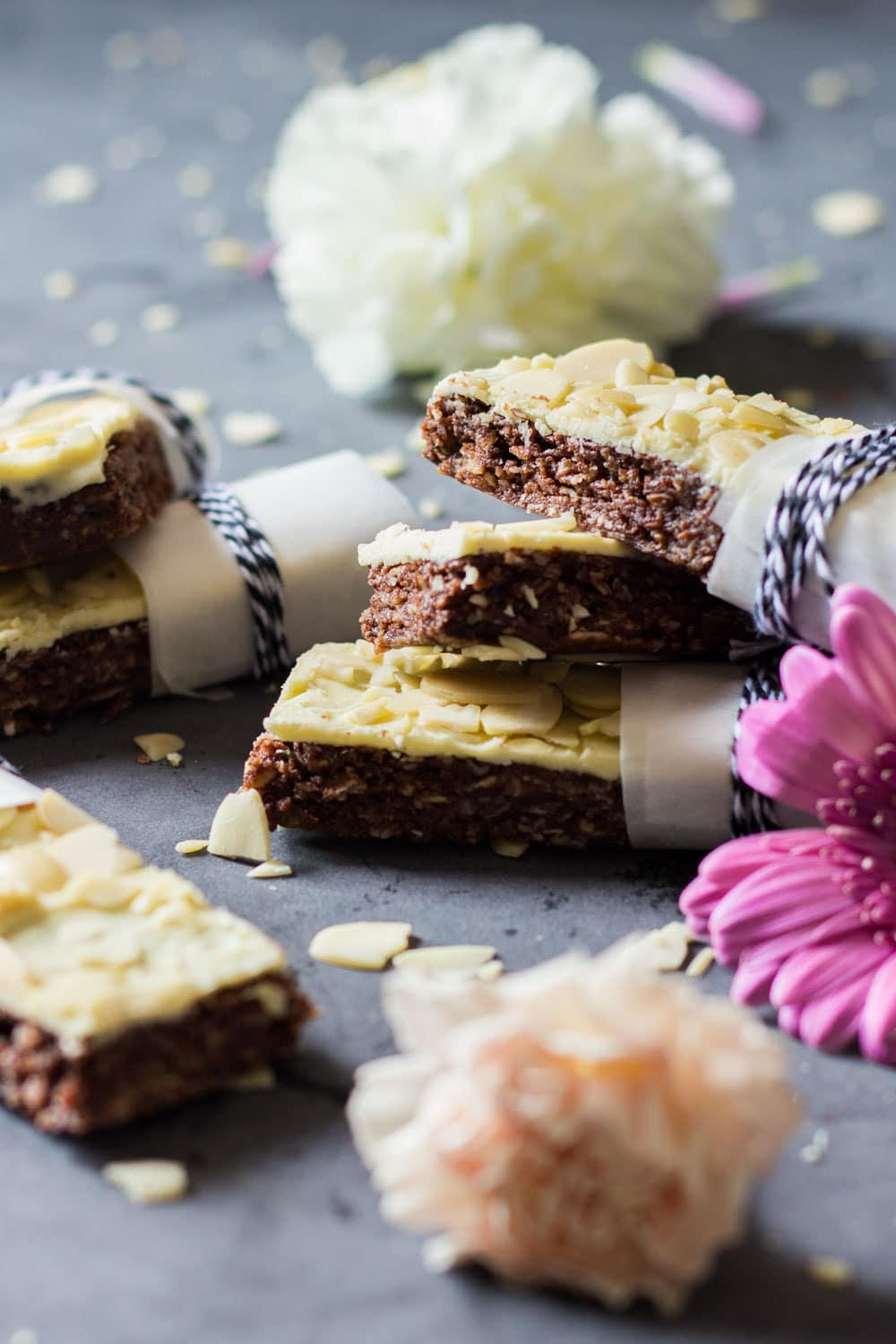These Almond Granola Bars are protein-rich and iron-rich easy no-bake granola bars sweetened with maple syrup and a tiny bit of white chocolate.