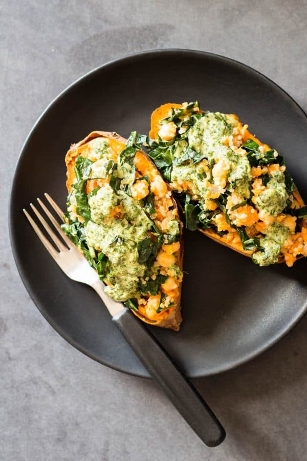 Vegan Stuffed Sweet Potatoes drizzled with Tahini Herb Sauce