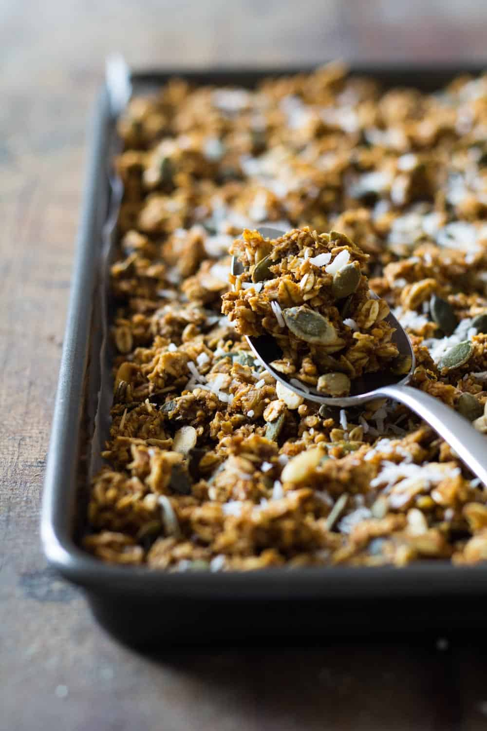 Close up of a spoon with Healthy Pumpkin Granola to show texture.