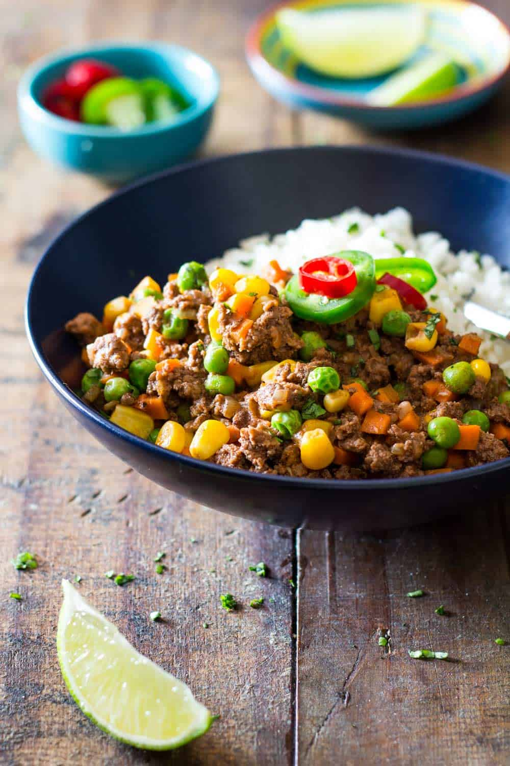 Mexican Picadillo served over rice in a dark blue bowl